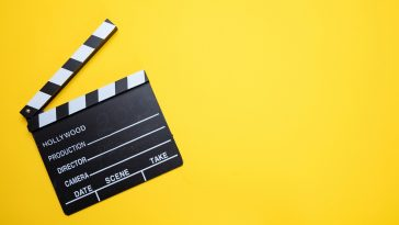 Broadcastnews movie clapperboard on yellow color background top