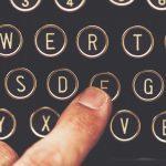broadcastnews finger on vintage typewriter machine