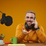 Broadcastnews radio worker talking on phone 01