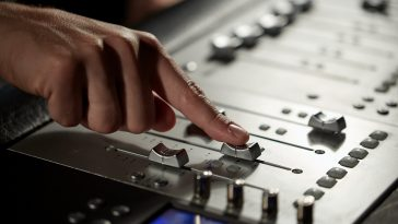 broadcastnews hand with mixing console in music recording studio 033 1