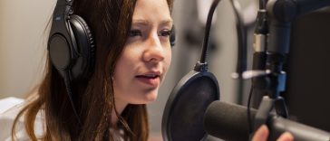 broadcastnews talking on microphone in radio studio 01