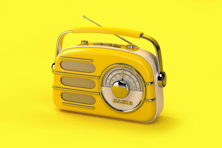 broadcastnews yellow vintage radio on yellow background 01