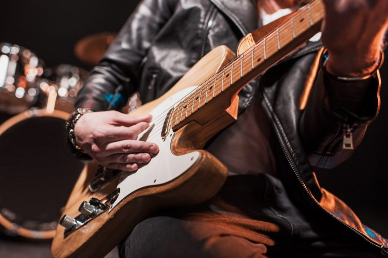close up partial view of rock star playing hard ro broadcastnews
